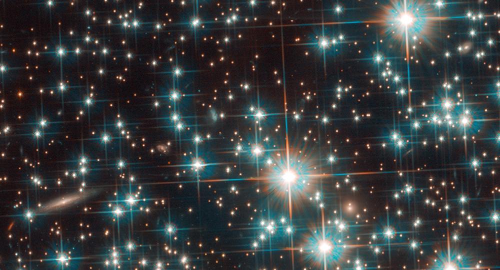 Galáxia, denominada temporariamente como Bedin-1, descoberta por acaso pelo telescópio Hubble