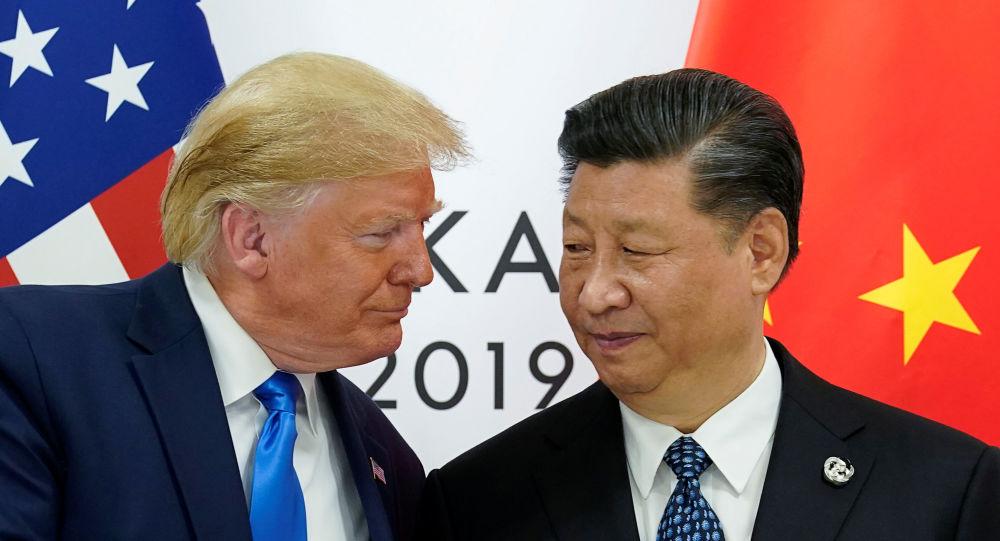 Presidente dos EUA, Donald Trump, e o presidente chinês, Xi Jinping, durante  a cúpula do G20, em Osaka, no Japão
