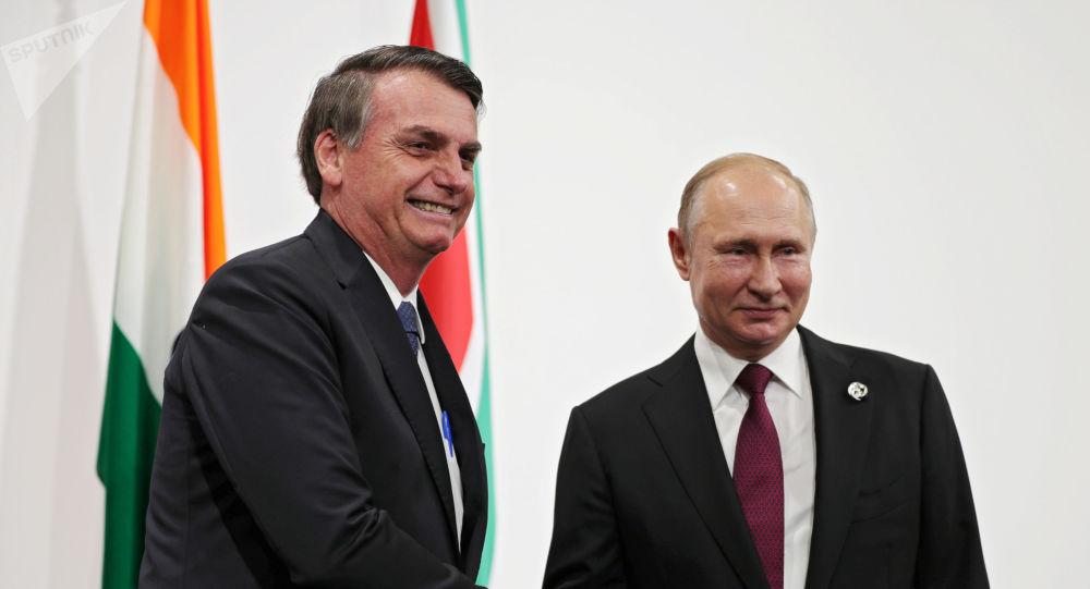 Líder russo Vladimir Putin se encontrou pela primeira vez com o presidente brasileiro Jair Bolsonaro em Osaka, palco do G20
