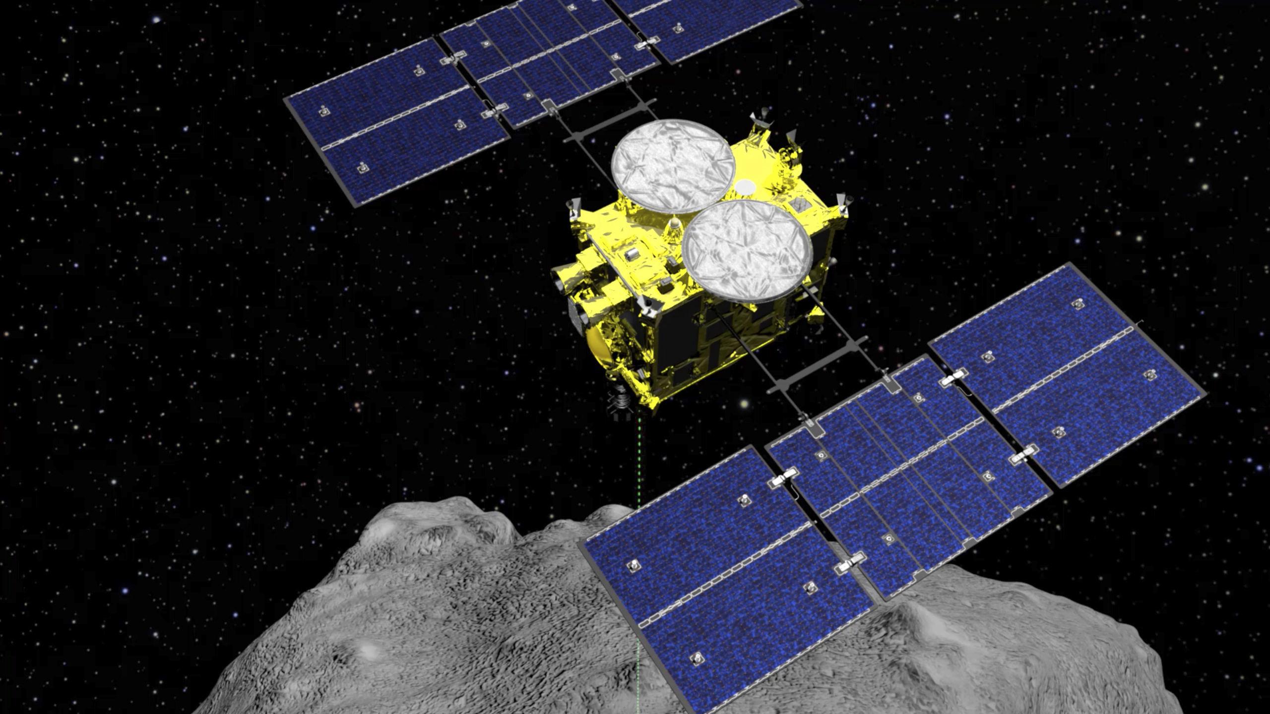 Imagem computadorizada da nave espacial Hayabusa 2 perto do asteroide Ryugu, em 5 de abril de 2019