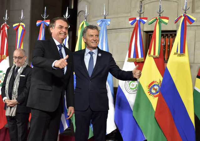 Presidente da Argentina, Mauricio Macri, e seu colega brasileiro, Jair Bolsonaro, na 54ª cúpula de presidentes do Mercosul