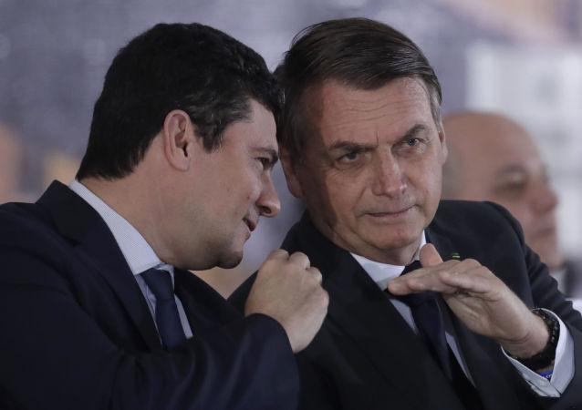 O ministro da Justiça e da Segurança Pública, Serio Moro, e o presidente Jair Bolsonaro durante evento em Brasília em 9 de agosto de 2019.