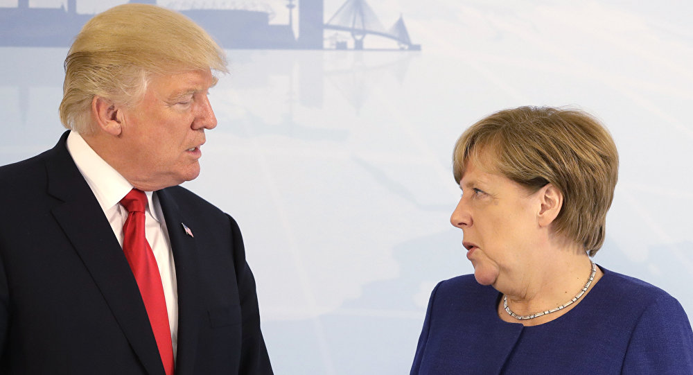 U.S. President Donald Trump, left, and German Chancellor Angela Merkel pose for a photograph prior to a bilateral meeting on the eve of the G-20 summit in Hamburg, northern Germany, Thursday, July 6, 2017