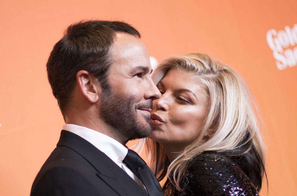 Designer Tom Ford com cantora Fergie em um evento beneficiário em Beverly Hills
