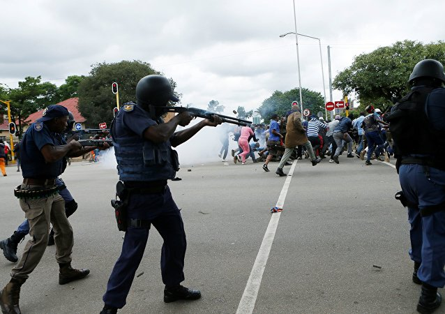 South African riot policemen fire rubber bullets to disperse Somali and foreign nationals clashing with South African nationals during a protest march against illegal immigrants on February 24, 2017 in Pretoria, South Africa.