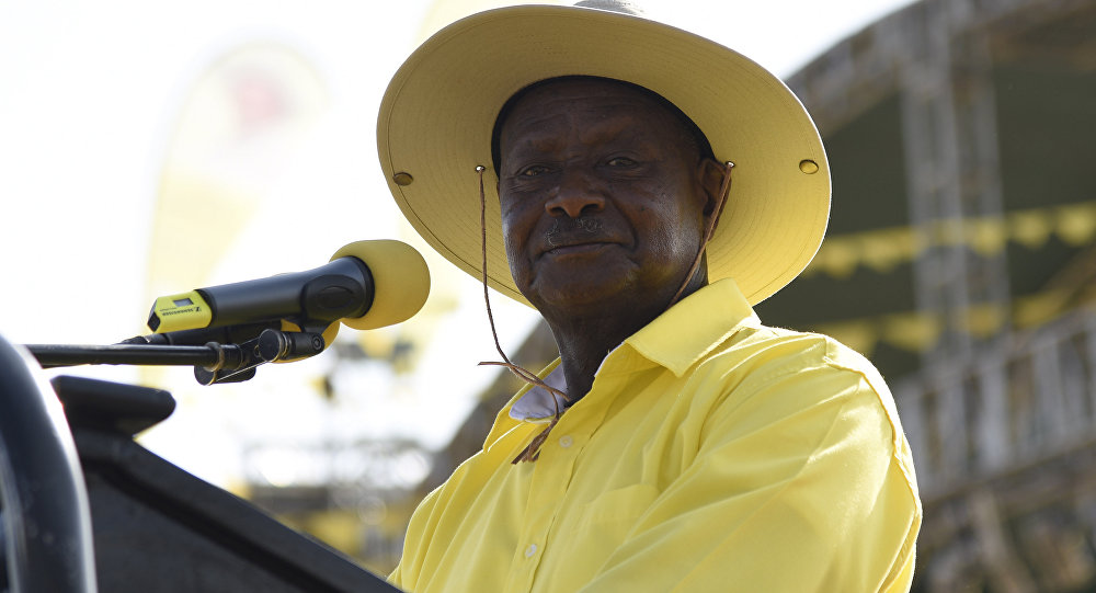 This file photo taken on February 16, 2016 shows Uganda's president Yoweri Museveni addressing supporters during a rally of the ruling National Resistance Movement (NRM) party at Kololo Airstrip in Kampala
