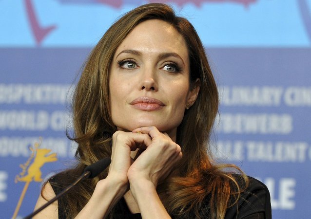 U.S. actress and director Angelina Jolie attends a news conference to promote the movie The Land Of Blood And Honey at the 62nd Berlinale International Film Festival in Berlin in this February 11, 2012 file photo