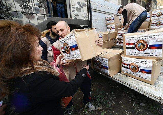 Distribuição da ajuda humanitária de várias comunidades religiosas da Rússia em Damasco