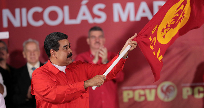 Ao som de reggaeton, Maduro inscreve candidatura em eleições controversas na Venezuela