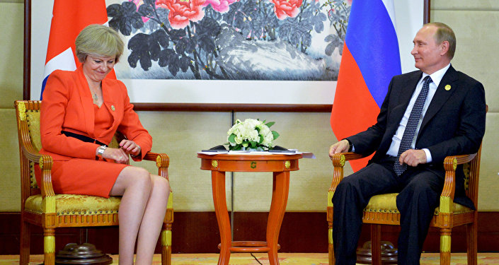 Russian President Vladimir Putin, right, listens to British Prime Minister Theresa May during a bilateral meeting in Hangzhou, China, Sunday, Sept. 4, 2016, ahead of the G20 Leaders Summit.