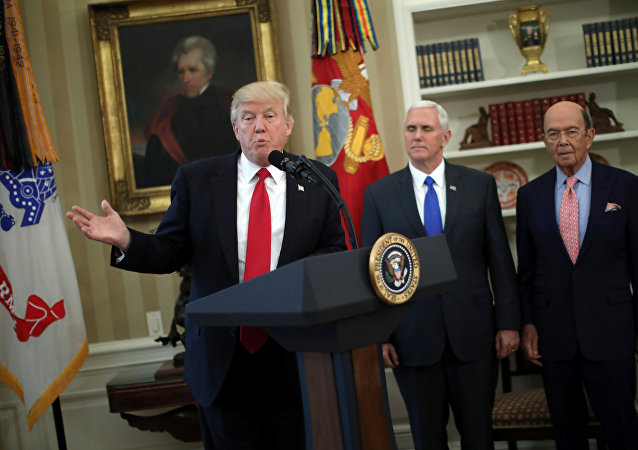 U.S. President Donald Trump speaks during a signing ceremony of executive orders on trade, accompanied by Vice President Mike Pence (C) and U.S. Commerce Secretary Wilbur Ross (R) at the Oval Office of the White House in Washington, U.S., March 31, 2017