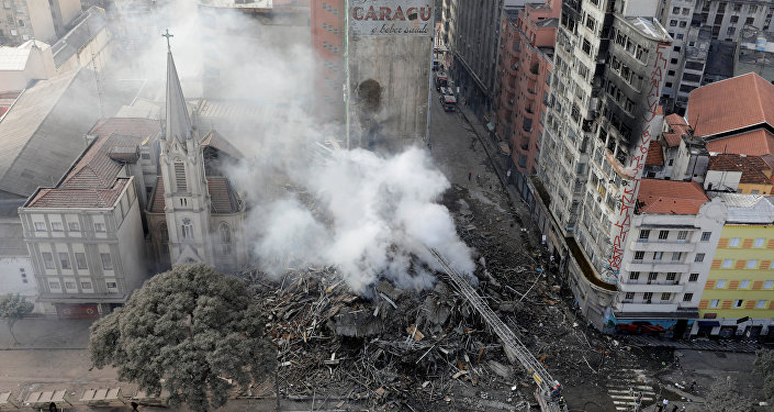 Firefighters try to extinguish a fire at a building in downtown Sao Paulo, Brazil May 1, 2018