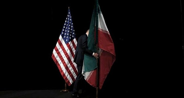 A staff member removes the Iranian flag from the stage after a group picture with foreign ministers and representatives of the U.S., Iran, China, Russia, Britain, Germany, France and the European Union during the Iran nuclear talks at the Vienna International Center in Vienna, Austria July 14, 2015