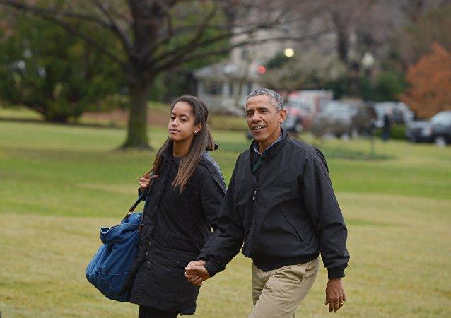 Barack Obama com a filha Malia