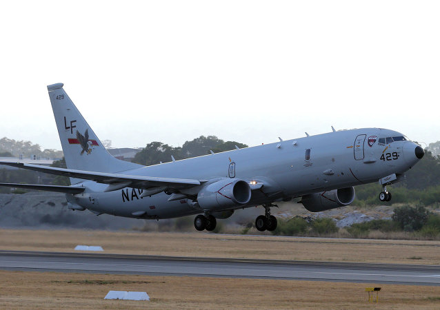 A U.S. Navy P-8 Poseidon takes off from Perth Airport in 2014.