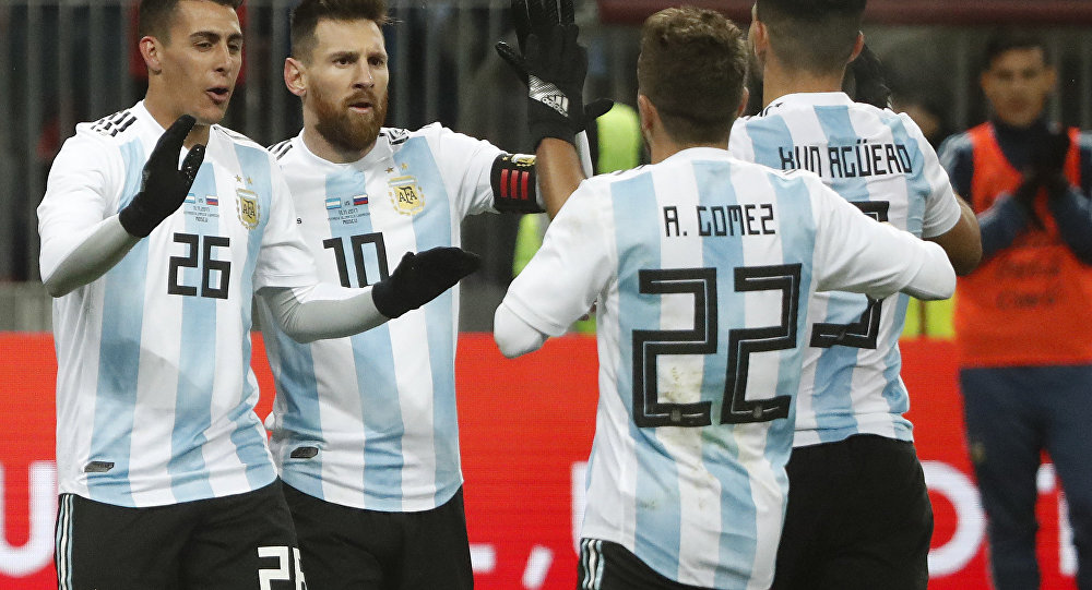Argentina's Sergio Aguero (9) celebrates with team mates Alejandro Gomez (22), Cristian Pavon (26) and Lionel Messi (10) after scoring his side's opening goal during the international friendly soccer match between Russia and Argentina at Luzhniki World Cup 2018 stadium in Moscow, Russia, Saturday, Nov. 11, 2017.
