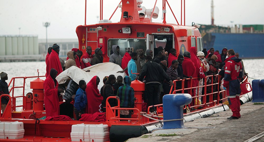 Migrants, who were part of a group intercepted aboard a dinghy off the coast in the Mediterranean sea, stand on a rescue boat upon arriving at a port in Malaga, southern Spain, December 3, 2016