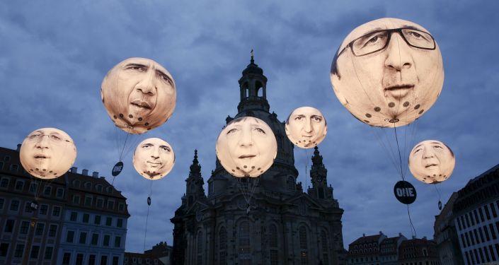 Balões com rostos de líderes dos países-membros do G7 perto da catedral de Frauenkirche, Dresde, em 27 de maio, dia da cúpula dos ministros das Finanças e chefes dos Bancos Centrais dos G7.