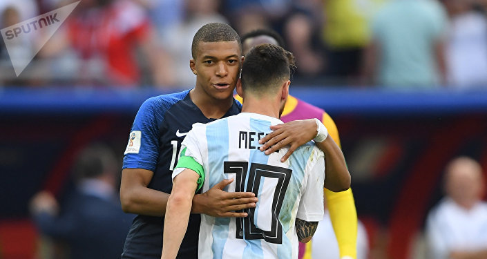 France's Kylian Mbappe, left, comforts Argentina's Lionel Messi after France's 4:3 victory in the World Cup Round of 16 soccer match between France and Argentina, at the Kazan Arena, in Kazan, Russia, June 30, 2018