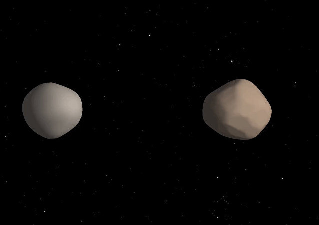 Asteroide binário 2017 YE5 (concepção artística)