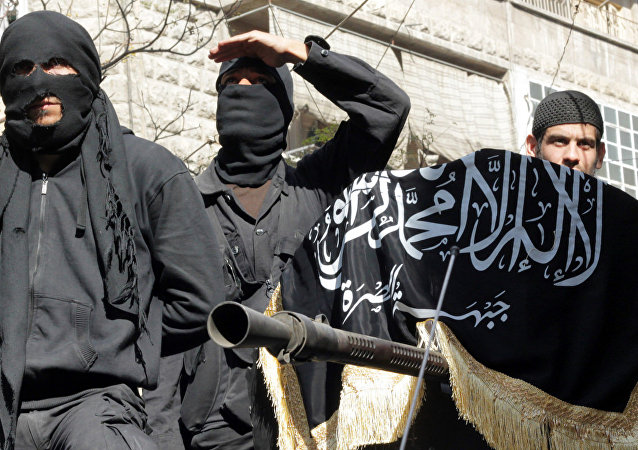 Members of jihadist group Al-Nusra Front take part in a parade calling for the establishment of an Islamic state in Syria, at the Bustan al-Qasr neighborhood of Aleppo, on October 25, 2013.