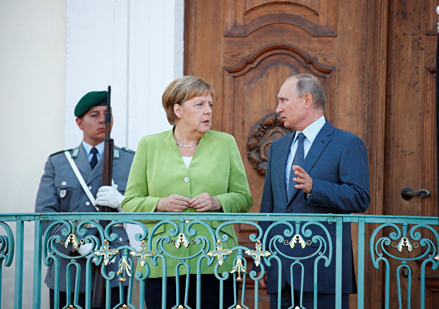 German Chancellor Angela Merkel and Russian President Vladimir Putin give statements ahead of a meeting at the German government guest house Meseberg Palace in Gransee, Germany August 18, 2018.