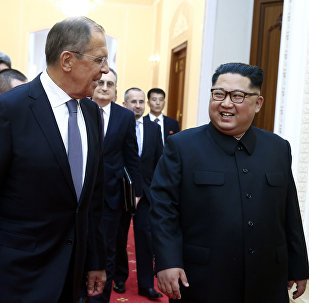 Russian Foreign Minister Sergei Lavrov, left, and North Korean leader Kim Jong Un meet in Pyongyang