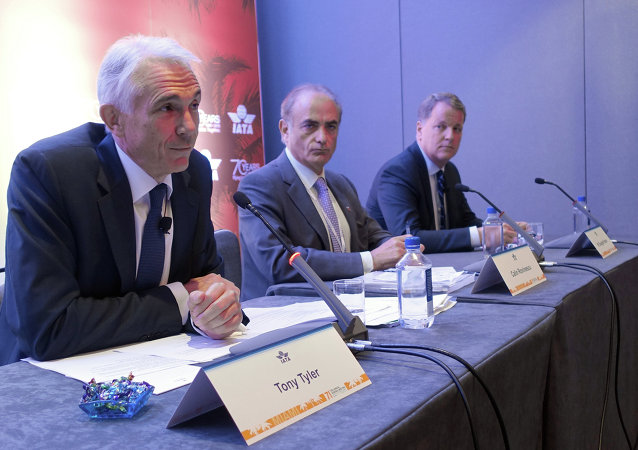 Global airline executives including Tony Tyler (L) address reporters during the 71st IATA Annual General Meeting and World Air Transport Summit in Miami Beach, Florida on June 8, 2015