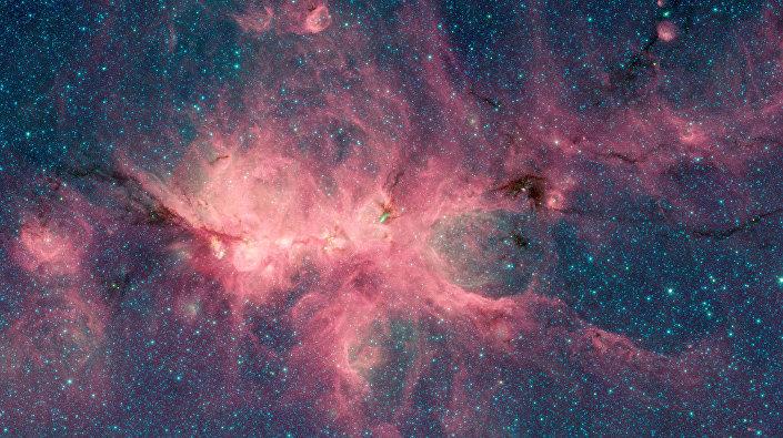 Imagem da Nebulosa Pata de Gato com elementos na forma de U obtida pelo telescópio Spitzer da NASA