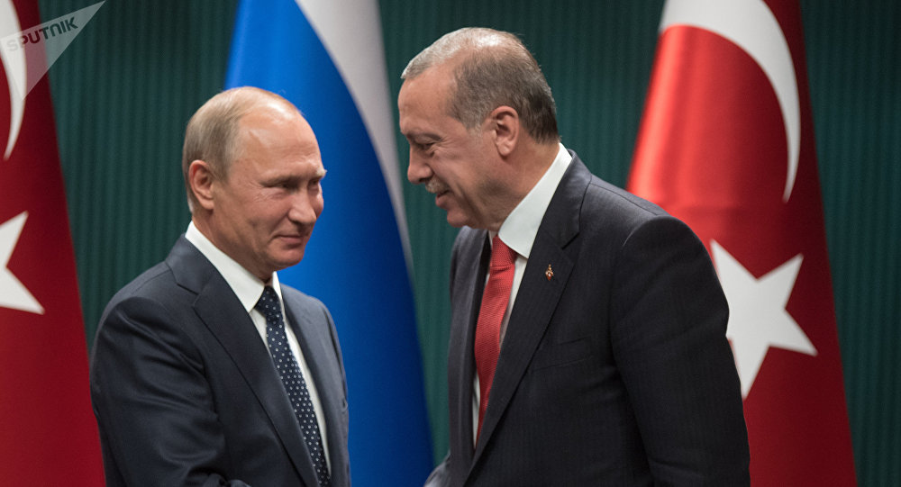 Russian President Vladimir Putin and Turkish President Recep Tayyip Erdogan, right, at a news conference following the Russian-Turkish talks in Ankara