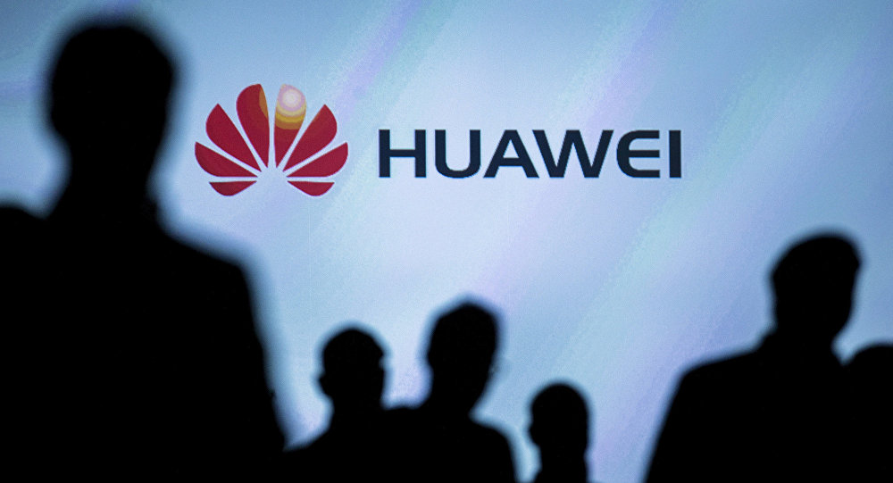 Journalists follow the presentation of a Huawei smartphone ahead of the IFA Electronics show in Berlin, Germany, September 2, 2015
