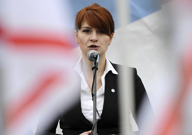 In this photo taken on Sunday, April 21, 2013, Maria Butina, leader of a pro-gun organization in Russia, speaks to a crowd during a rally in support of legalizing the possession of handguns in Moscow, Russia
