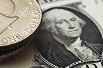 Nota e moeda de um dólar americano