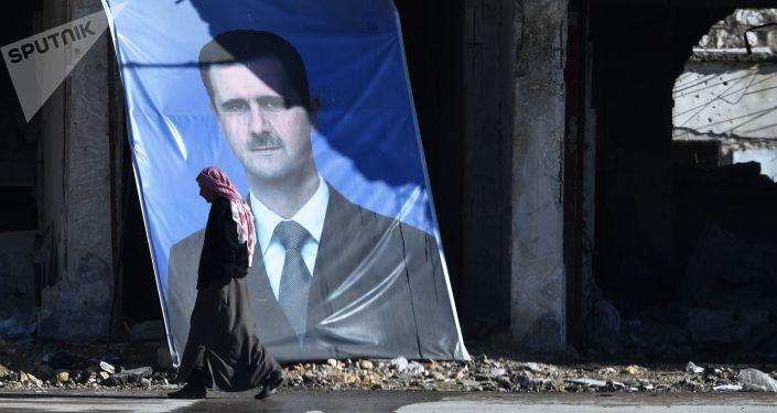 Retrato do presidente da Síria, Bashar Assad, no subúrbio de Aleppo