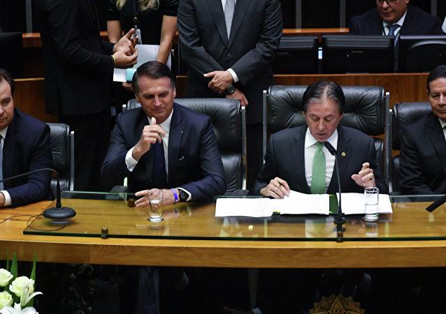 O presidente da Câmara dos Deputados, Rodrigo Maia, novo presidente brasileiro, Jair Bolsonaro, presidente do Senado, Eunicio Oliveira e o vice-presidente Hamilton Mourão durante a cerimônia de posse