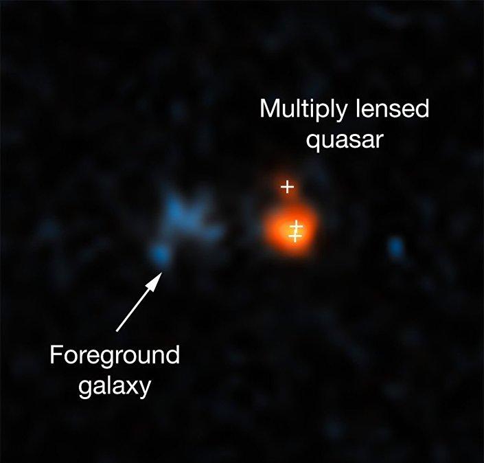 Quasar J043947.08 + 163415.7, observado com o telescópio Hubble