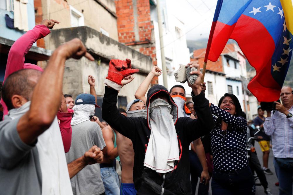 Manifestantes em Caracas, Venezuela