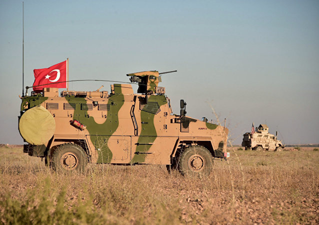 In this photo taken Thursday, Nov. 1, 2018, Turkish and U.S. troops conduct joint patrols around the Syrian town of Manbij, as part of an agreement that aimed to ease tensions between the two NATO allies