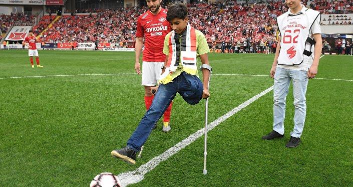 Qassem Qadim durante partida de futebol em Moscou