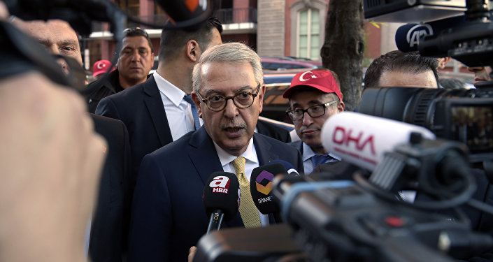 (File) Turkish Ambassador Serdar Kilic, center, speaks to reporters and supporters near the White House in Washington, Monday, May 15, 2017
