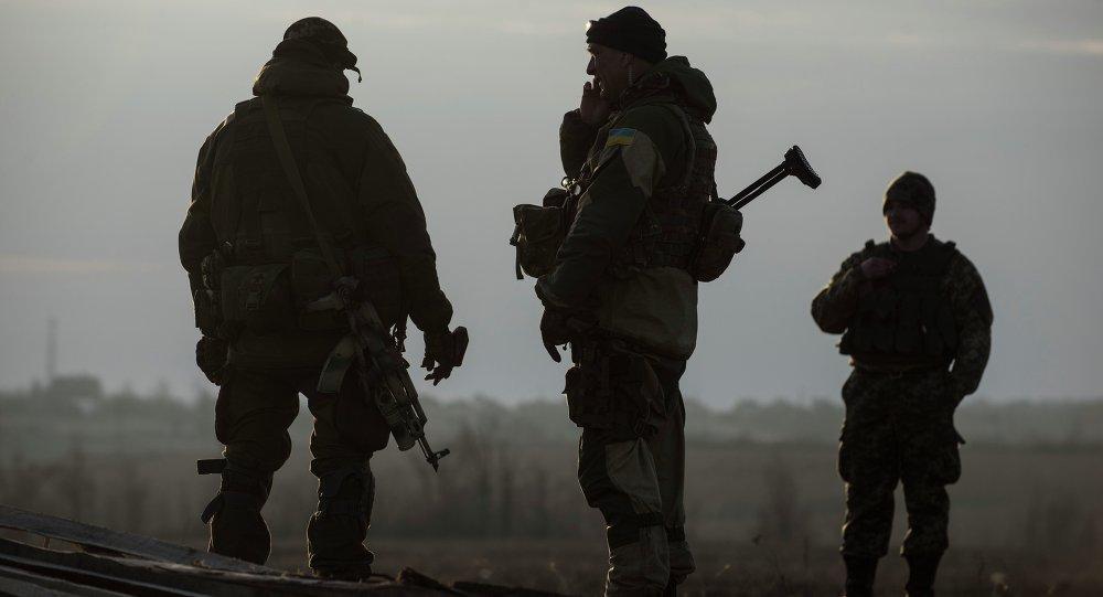 Ukrainian servicemen guard their position in the village of Shirokino near Mariupol, eastern Ukraine, Wednesday, Feb. 25, 2015