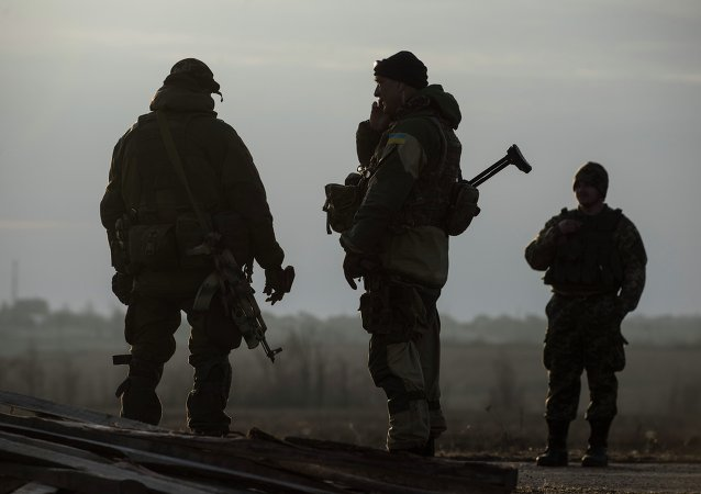 Ukrainian servicemen guard their position in the village of Shirokino near Mariupol, eastern Ukraine, Wednesday, Feb. 25, 2015