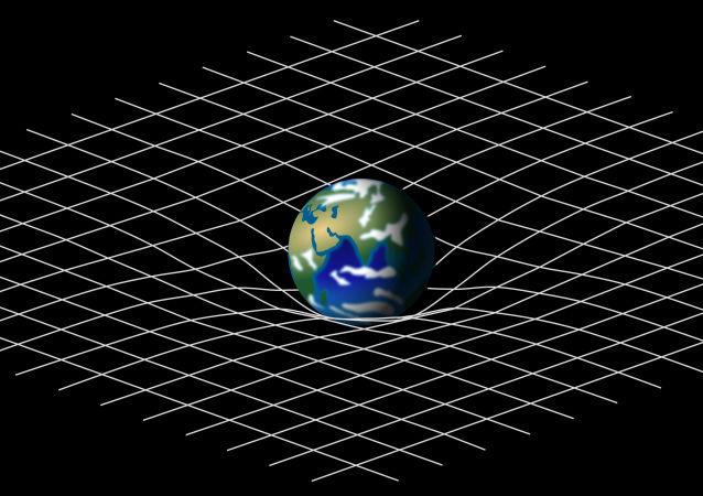 Analogia em malha da deformação do espaço-tempo causada por uma massa planetária