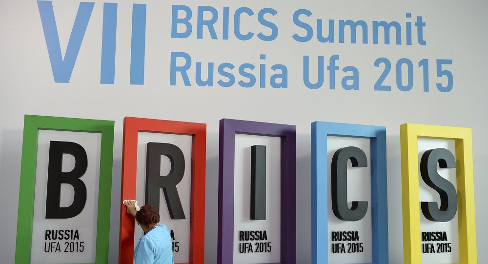 An employee cleans a board during the preparations for the BRICS summit in Ufa, Russia, July 7, 2015.