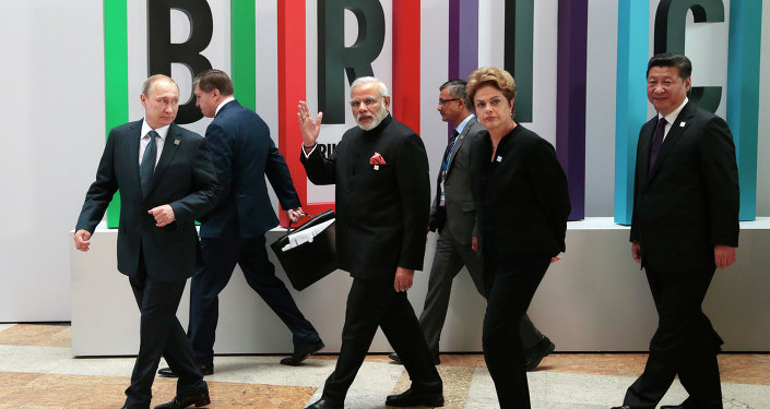 From left in front row: Russian President Vladimir Putin, Indian Prime Minister Narendra Modi, Brazilian President Dilma Rousseff, Chinese President Xi Jinping walk for a plenary session during the summit in Ufa, Russia, Thursday, July 9, 2015