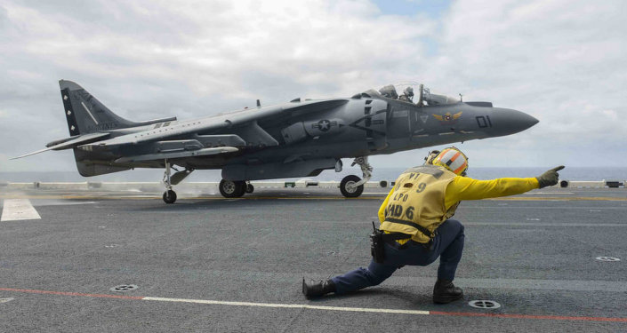 An AV-8B Harrier, assigned to the Marine Attack Squadron 231(VMA), takes off from the flight deck of forward-deployed amphibious assault ship USS Bonhomme Richard.