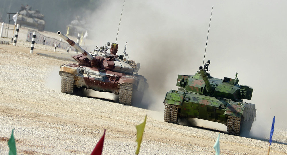 From right: Chinese and Russian crews ride Type 96A and T-72B tanks during a pursuit race of the Tank Biathlon 2014 World Championships at a training center of the Second Guards Taman Motorized Rifle Division in the town of Alabino