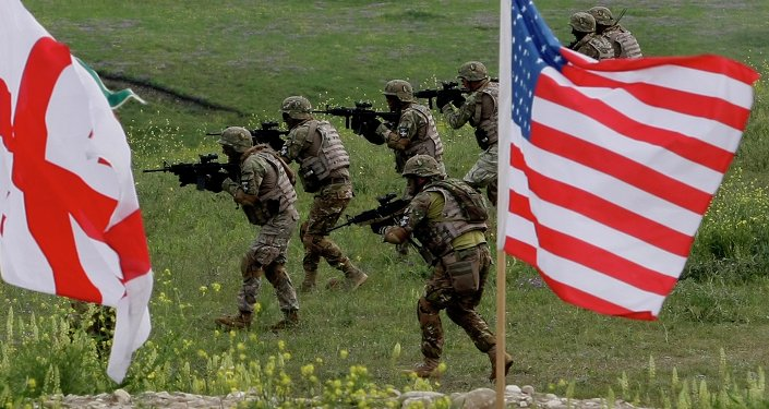 US and Georgian servicemen, with Georgian and US flags in front, take part in the joint US-Georgia military exercise at the Vaziani base outside the Georgian capital, Tbilisi, Georgia, Thursday, May 21, 2015