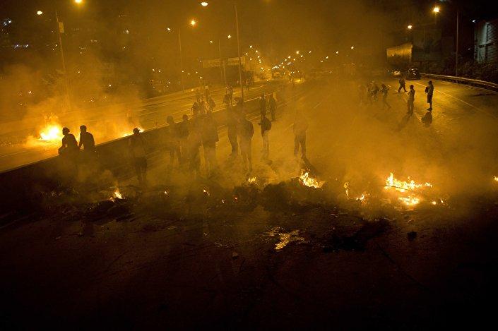 Os protestos de 12 de fevereiro de 2014 (na foto) terminaram na morte de 43 pessoas