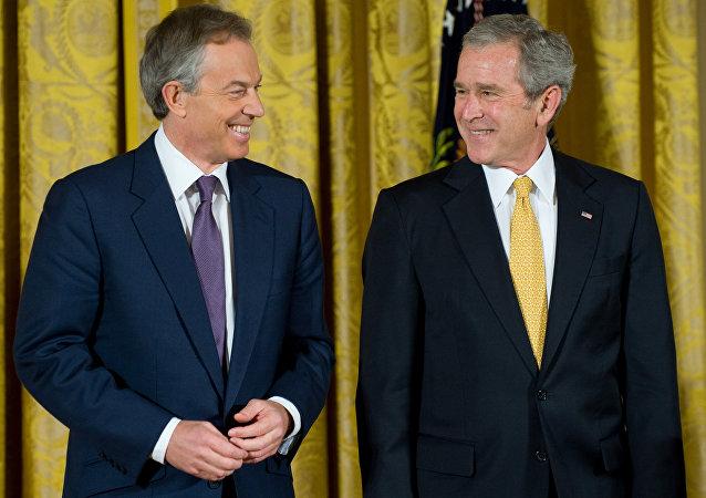 O ex-premier britânico, Tony Blair, com o ex-presidente norte-americano George W. Bush